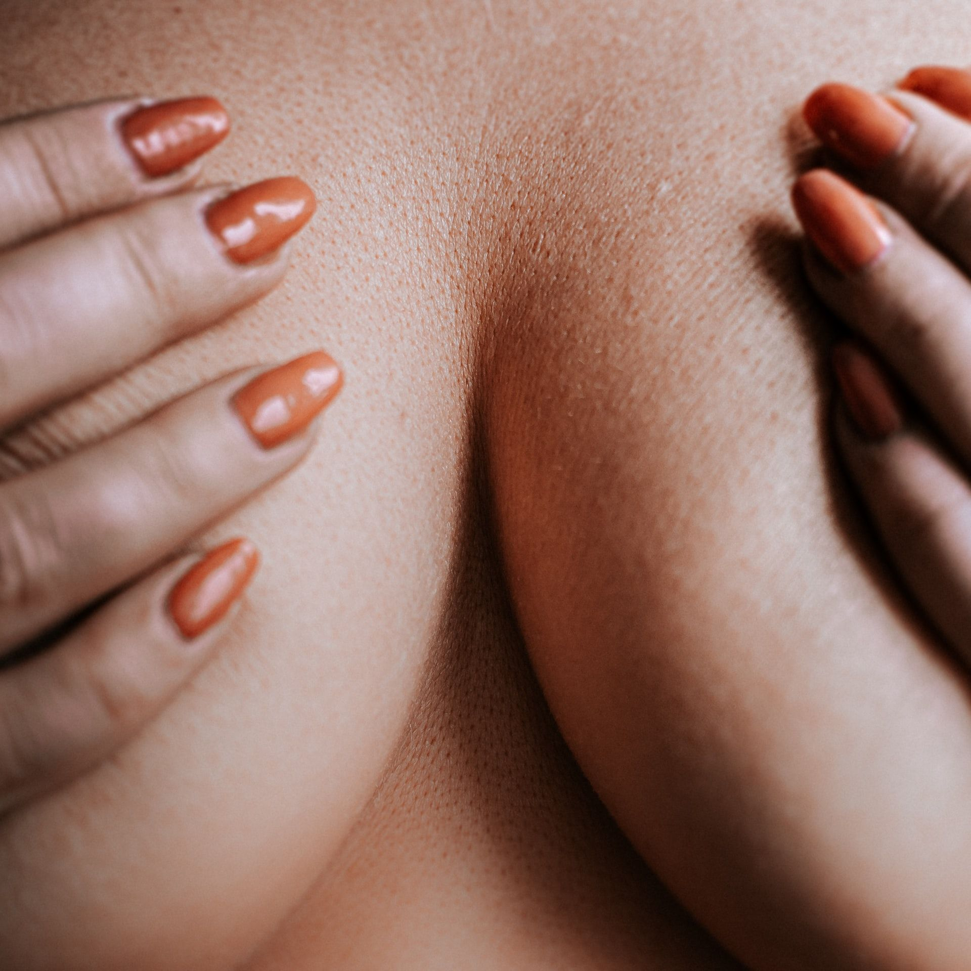 Woman covering her breasts